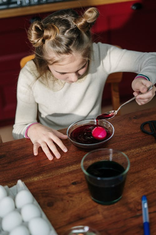 Girl Making Red Easter Egg