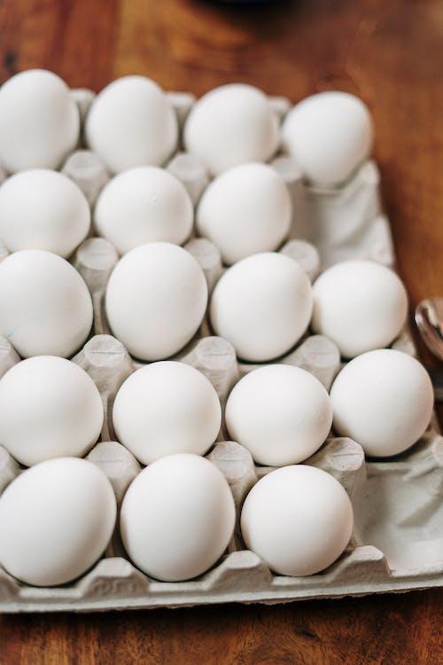 White Eggs on White Tray