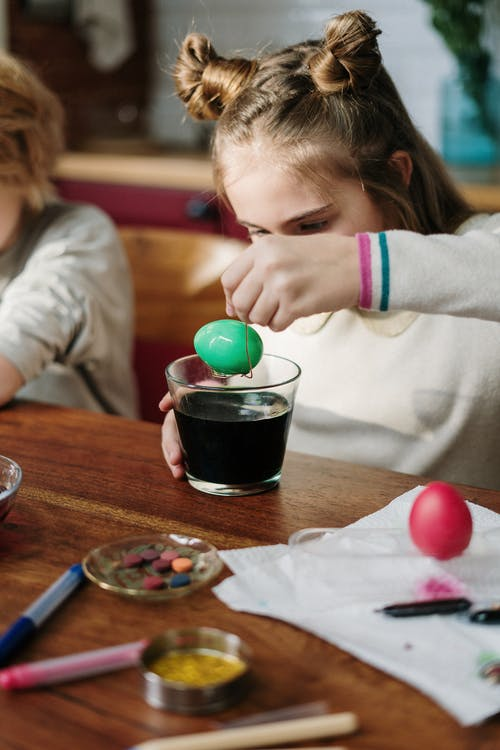 Girl Making Green Easter Egg