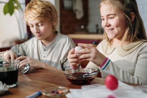 Kids Making Colorful Easter Egg