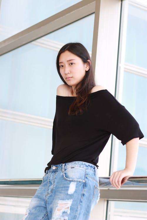 Woman Wearing Black Scoop-neck Shirt