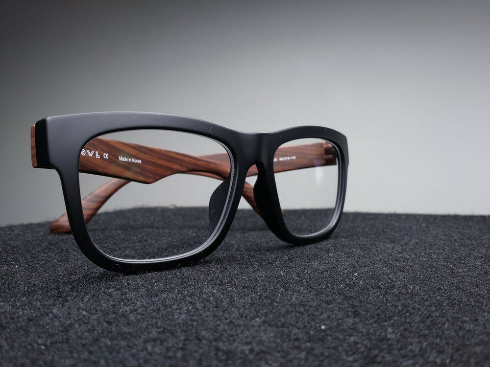 Black Framed Eyeglasses on Black Surface