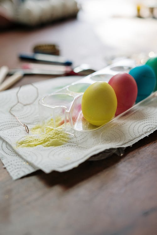 Yellow and Red Egg on White Textile