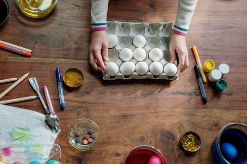 Person Holding White Egg Tray
