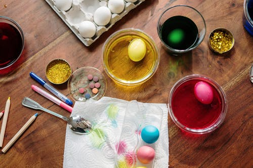 Eggs Dip on Glasses With Different Colored Liquids