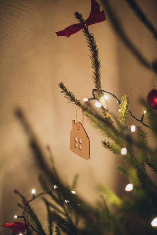 Brown Wooden House Ornament Hanging on Christmas Tree