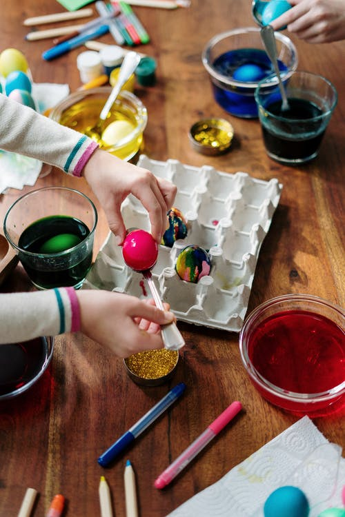 Person Making Tie Dye Easter Egg