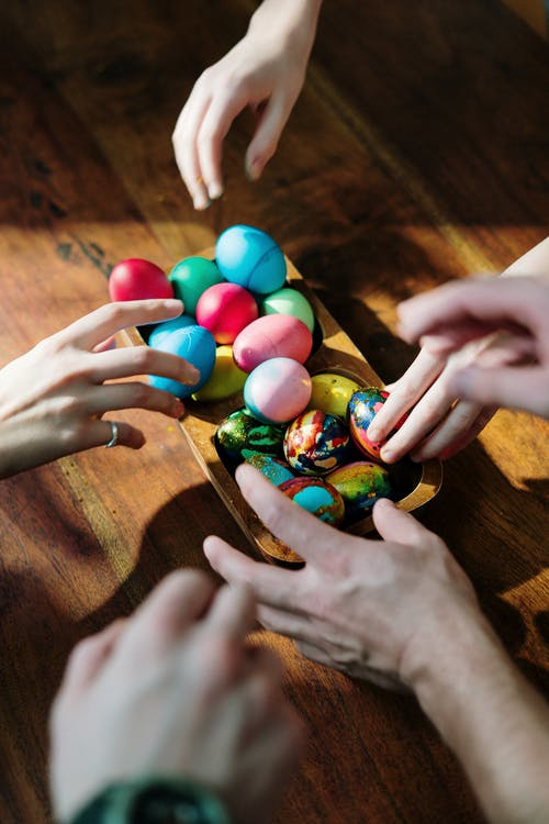 People  Holding Assorted Easter Eggs
