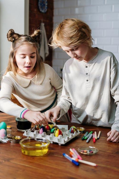 Kids Having Fun Making Easter Eggs