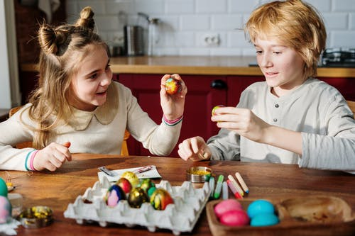 Childred Decorating Eggs