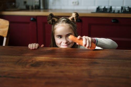 Girl Holding Fresh Carrot
