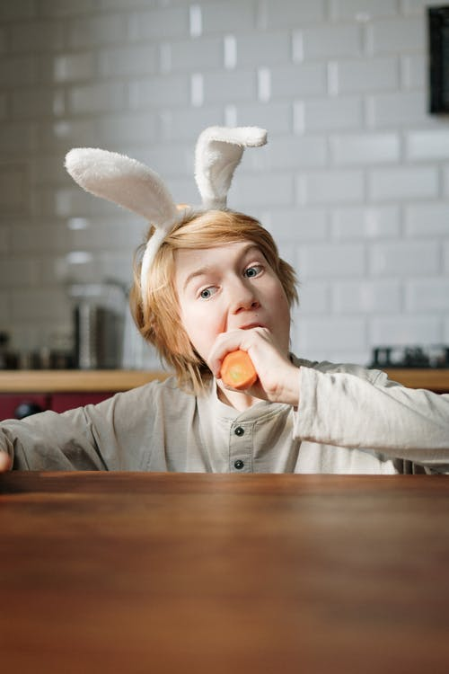 Boy Eating Carrot