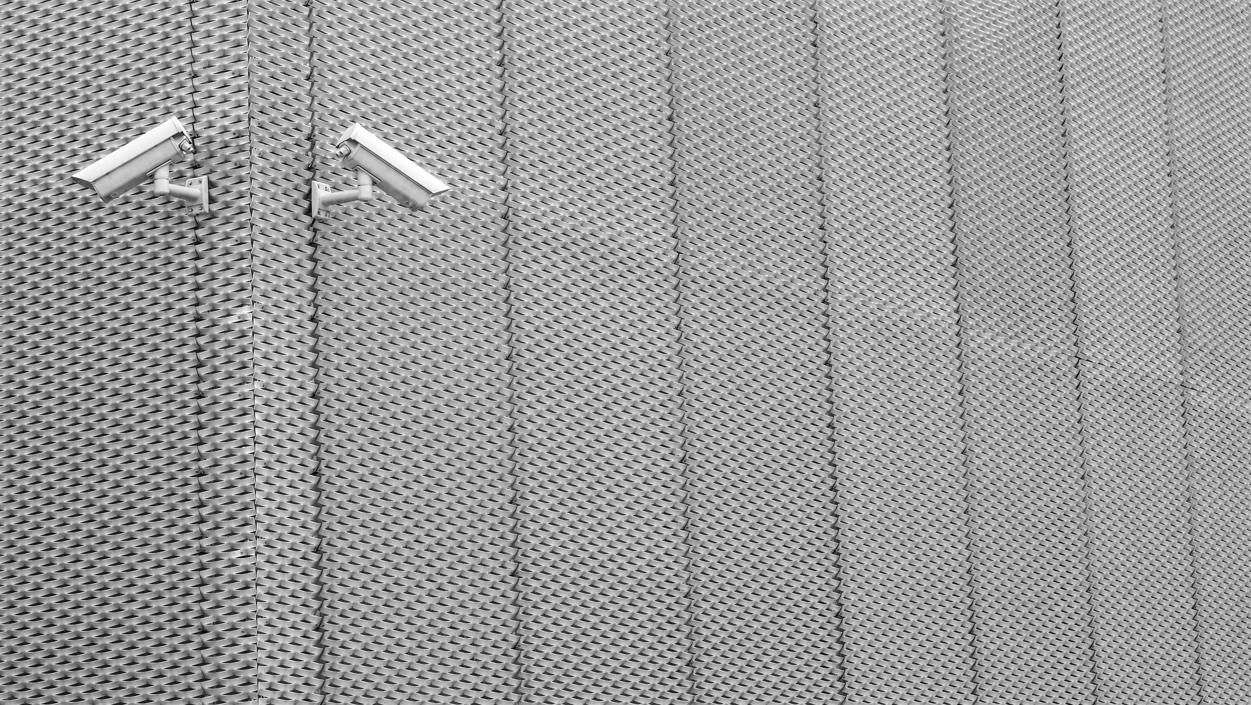 Two Gray Cctv Cameras on Wall
