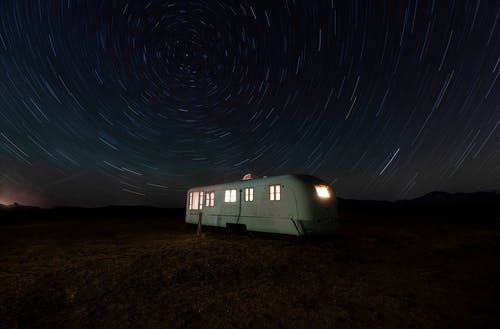 White and Gray Camper Trailer Under Starry Night