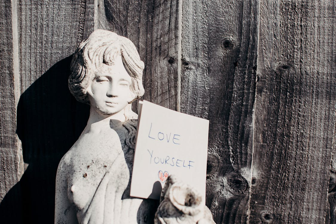 Love Yourself Card On Statue