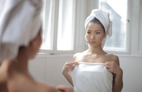 Woman Covered in White Towel