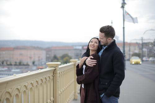 Dating Couple Standing on the Bridge