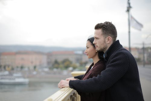 Couple Standing on the Bridge