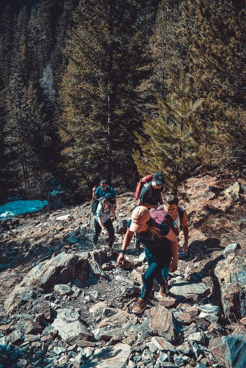 People Hiking On Rocky Mountain