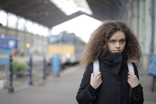 Girl in Black Trench Coat Standing on Sidewalk