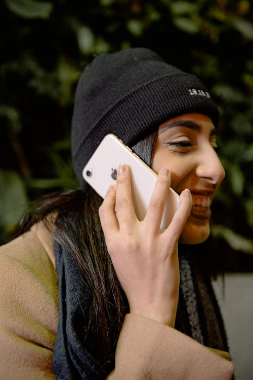 Woman In Black Knit Cap Holding A Phone