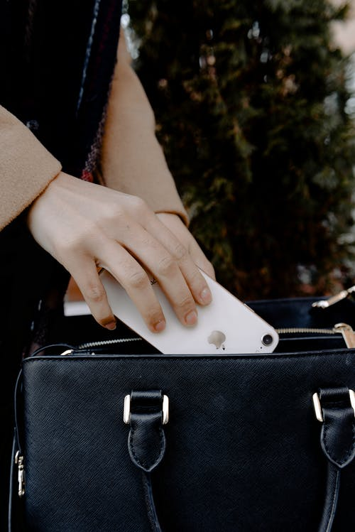 Person Holding Black Leather Handbag