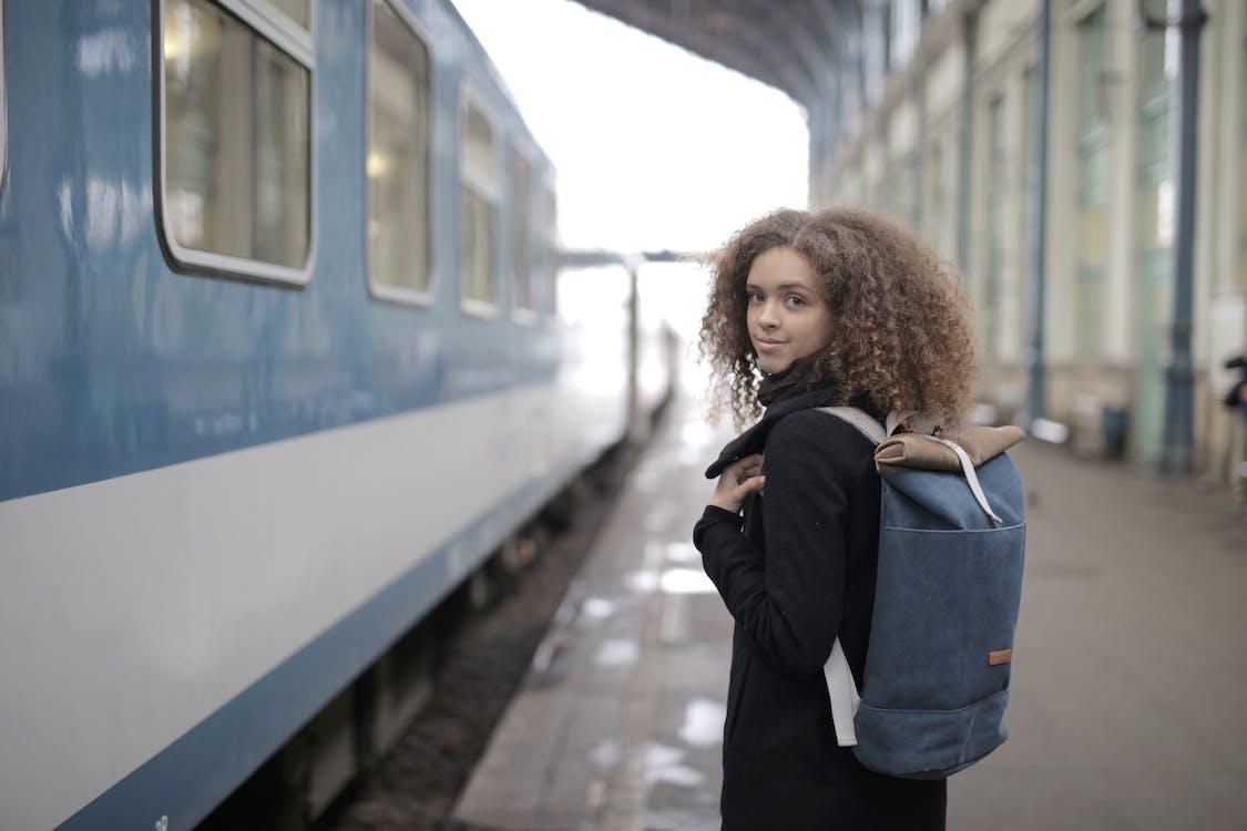 Girl in Black Jacket Standing Beside Train