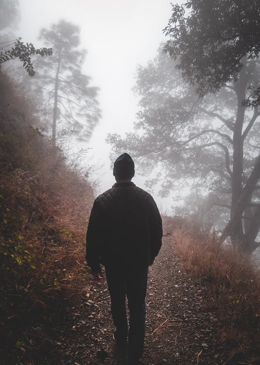 Man in Black Jacket Walking
