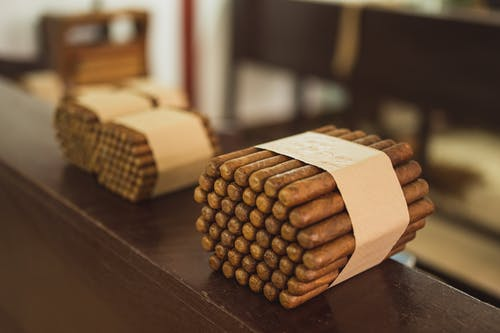 Stacks of raw packed cigars in fabric