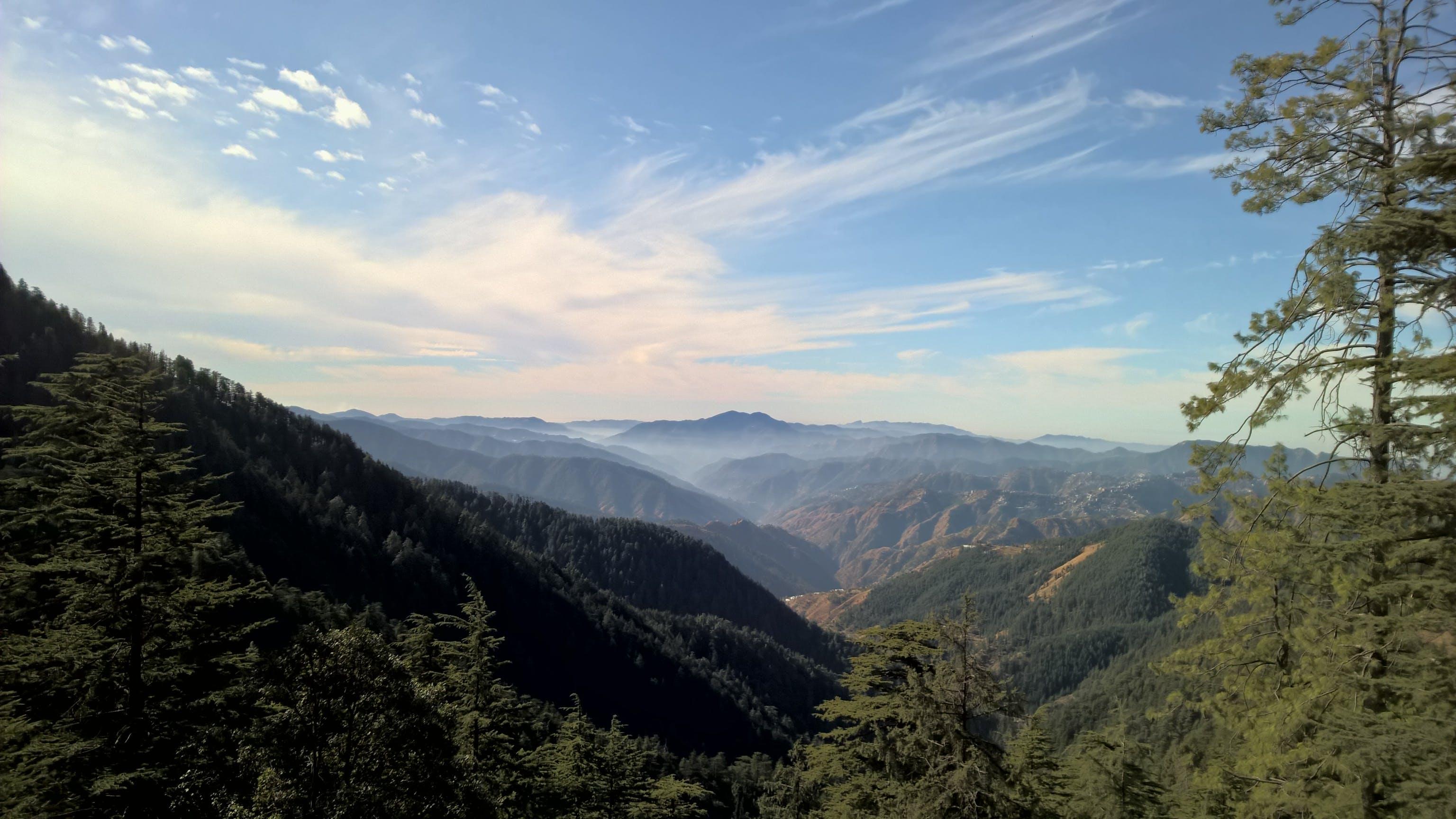 Bird's-eye View of Mountain Under Cloudy Sky