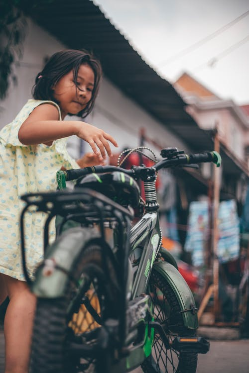 Girl Holding A Bicycle