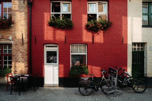 Bicycles Parked Beside Red Brick Building