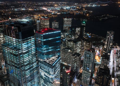 Aerial Shot Of City Buildings During Night Time