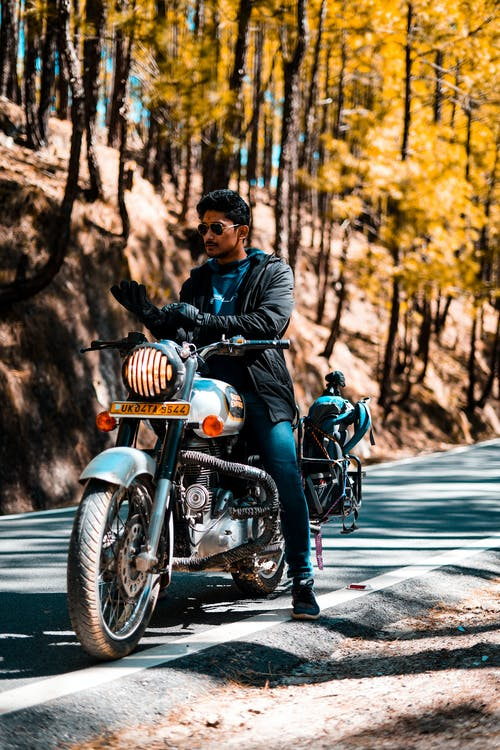 Man In Black Jacket Riding A Motorcycle