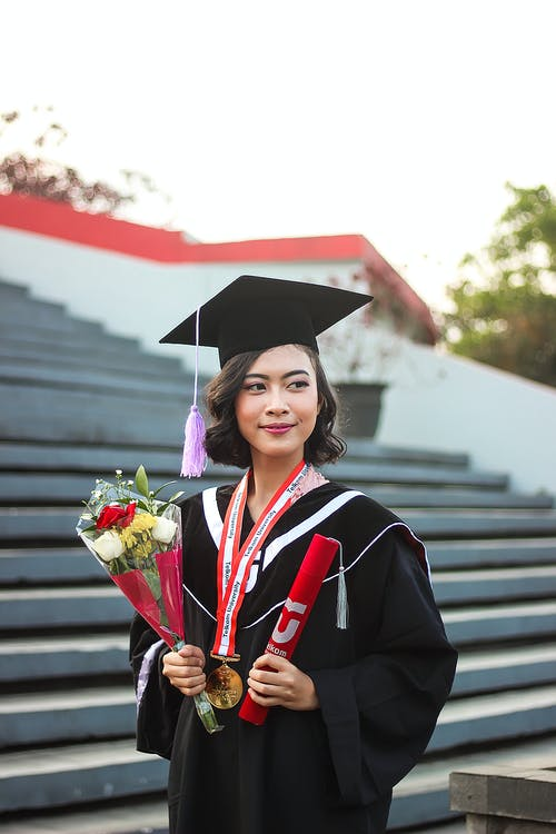 Woman In Academic Dress And Graduation Hat