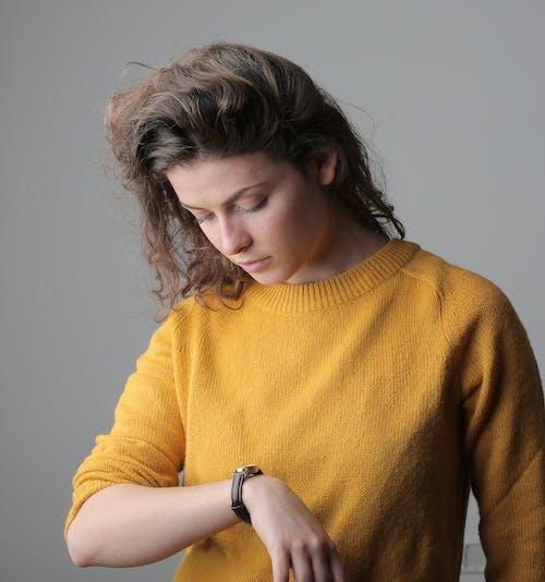 Woman in Yellow Sweater Wearing Brown Watch