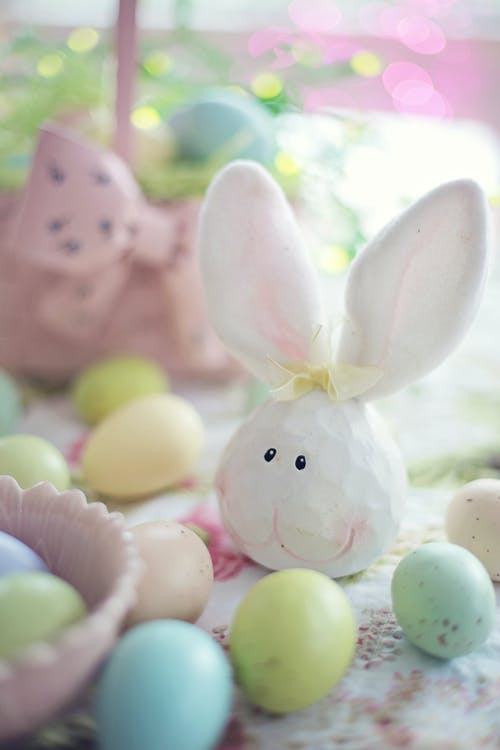 White Rabbit Figurine Beside Easter Eggs