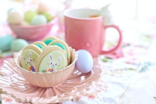 Easter Cookies Beside Pink Ceramic Mug