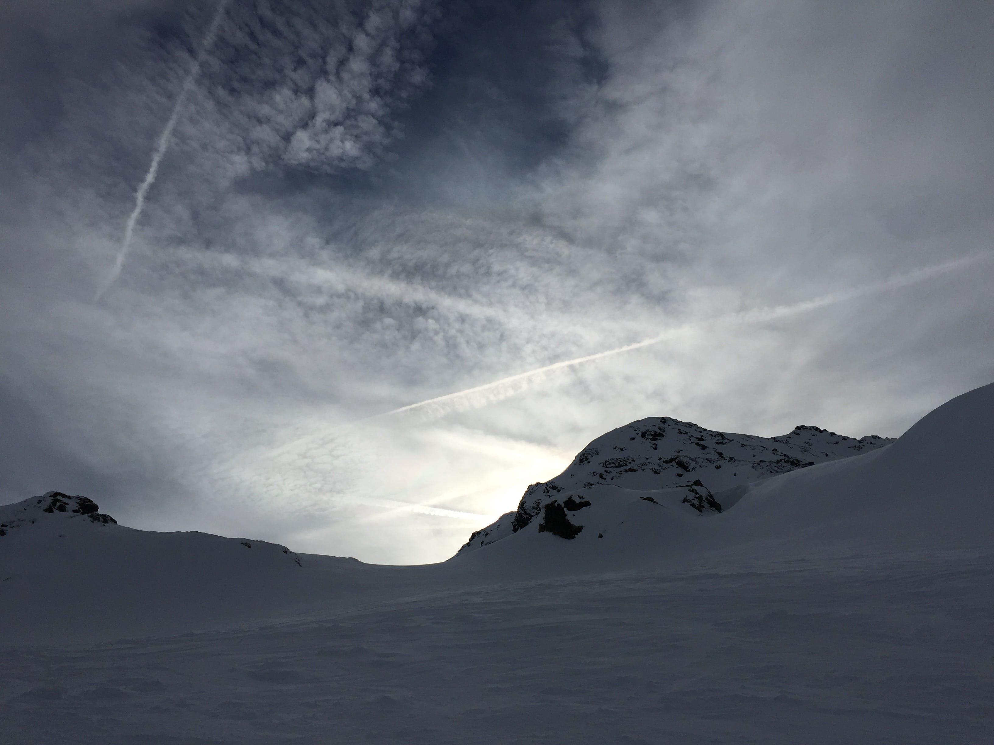 Free stock photo of cloud formation, evening sun, mountain peak, winter landscape