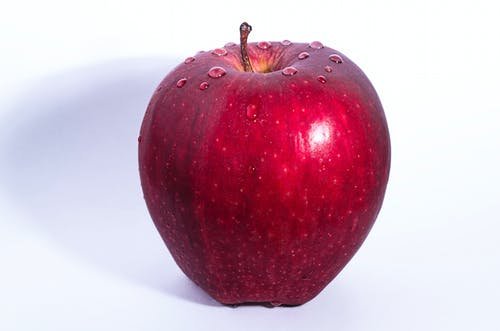 Selective Focus Photo of Delicious Red Apple Fruit With White Background