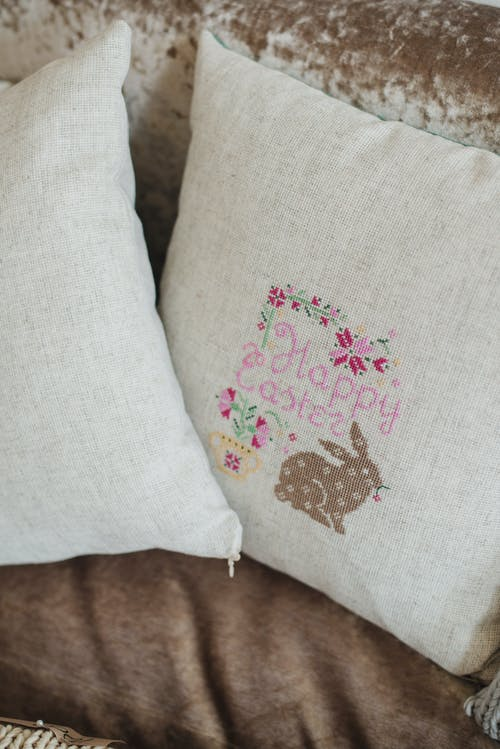 Pair of linen decorative pillows with Easter pattern