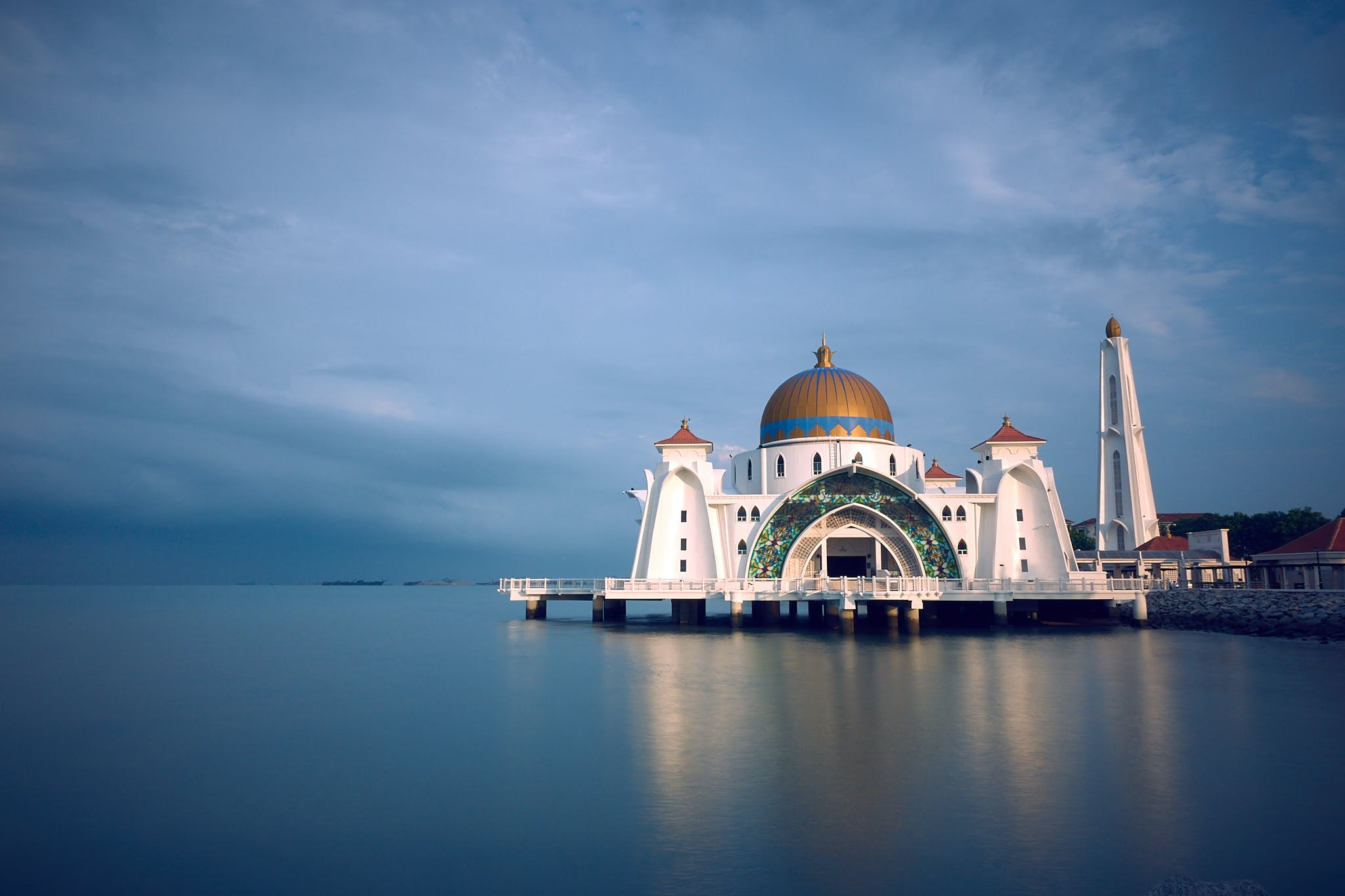 White and Brown Mosque Beside Body of Water
