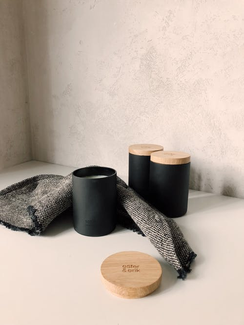 Candles In Black Containers