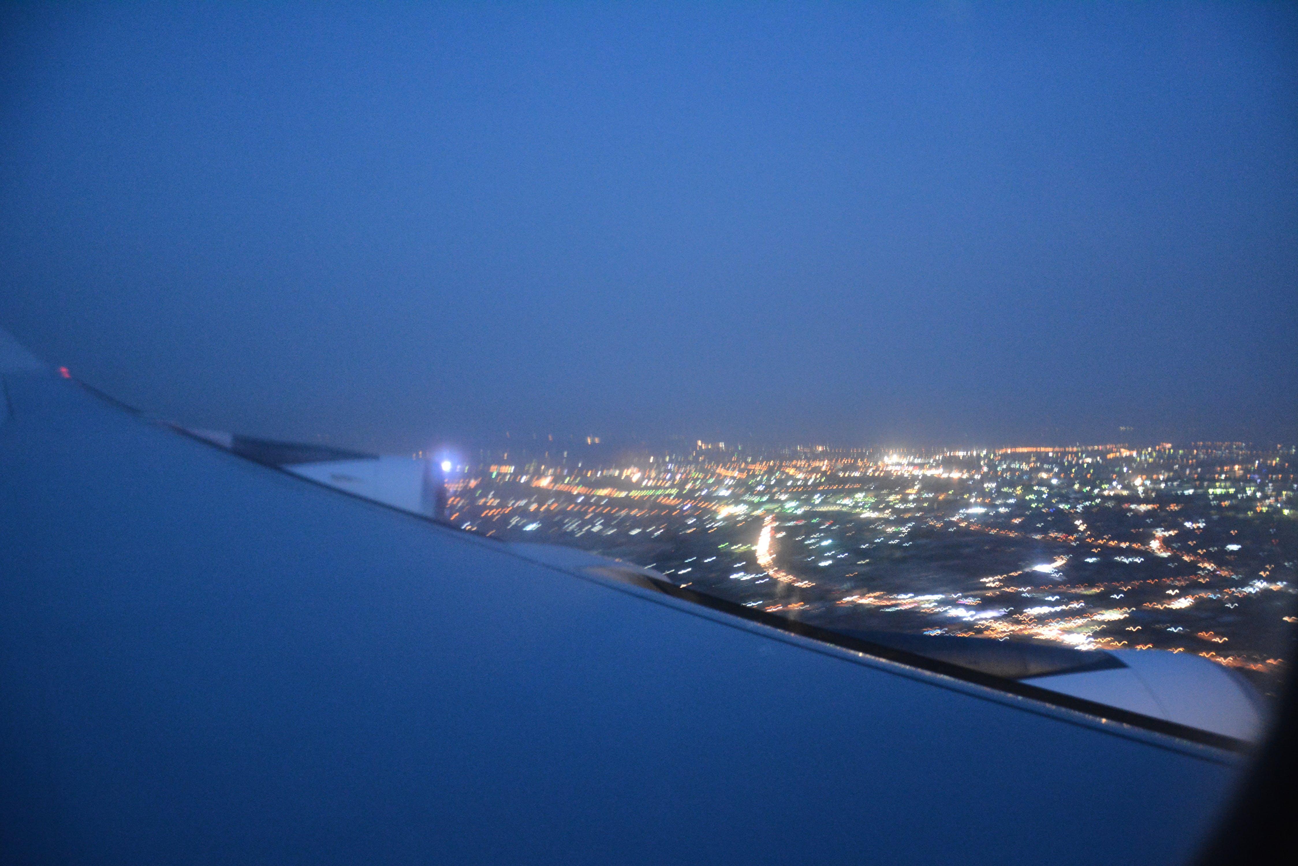 Free stock photo of airplane view, blue sky, city at night, night lights