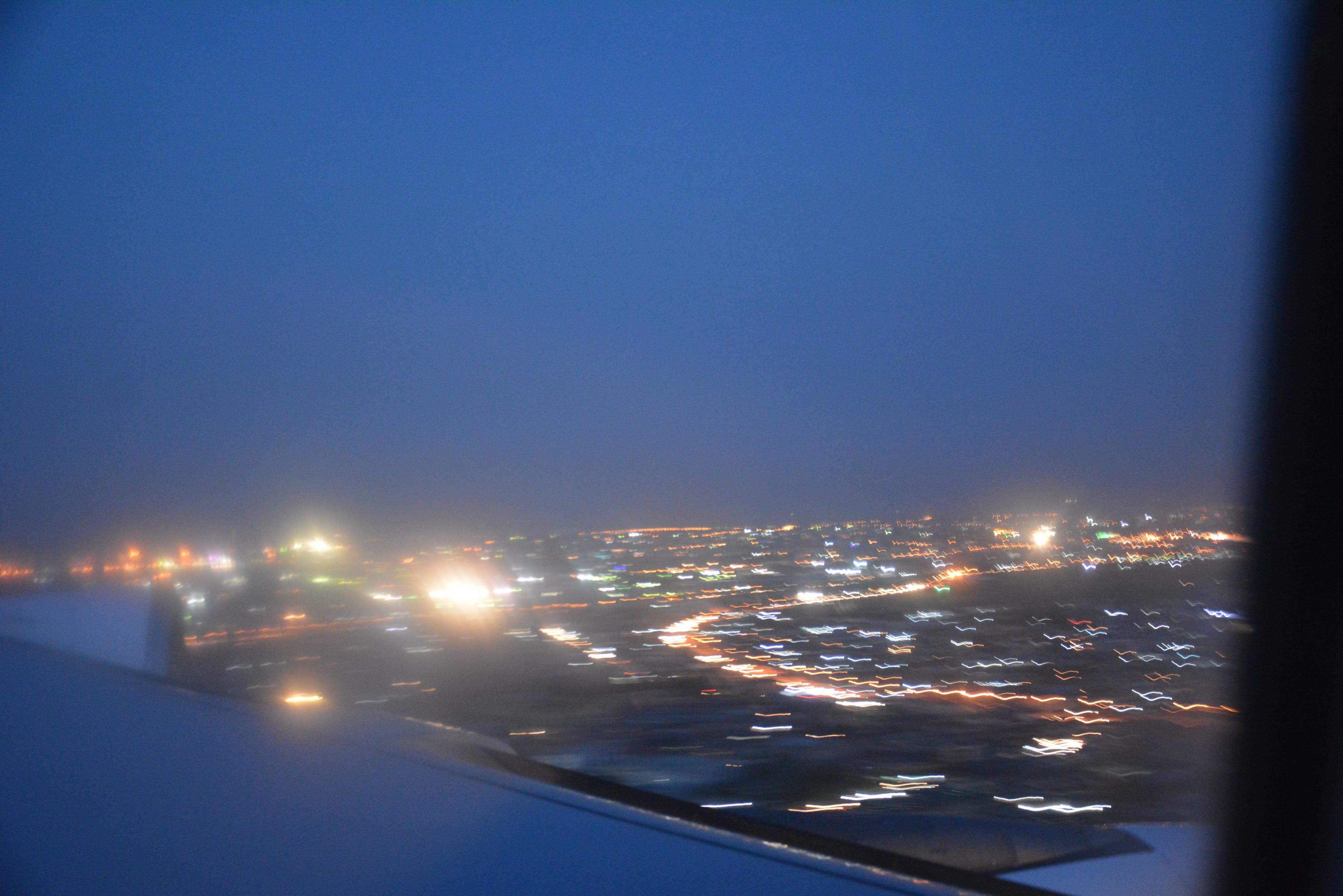 Free stock photo of airplane view, blue skies, city lights, night lights