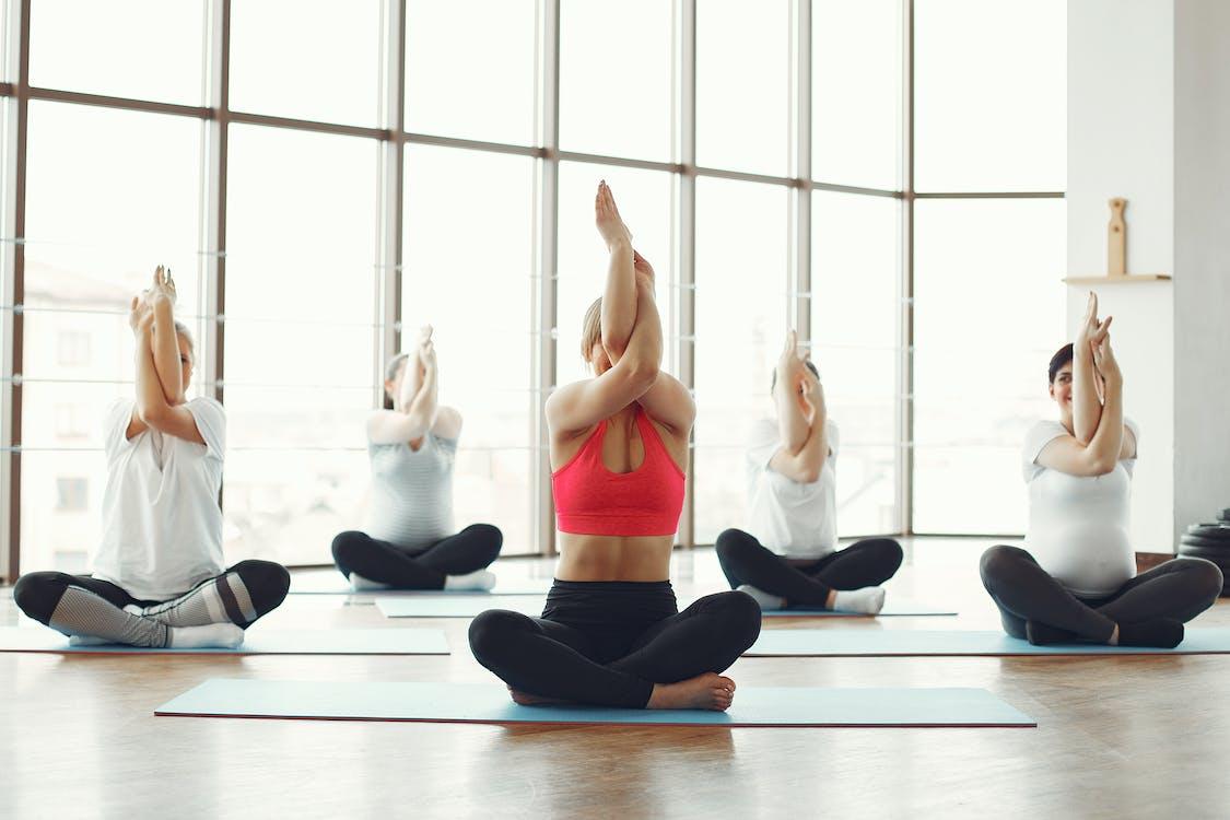 Women in Activewear Doing Yoga