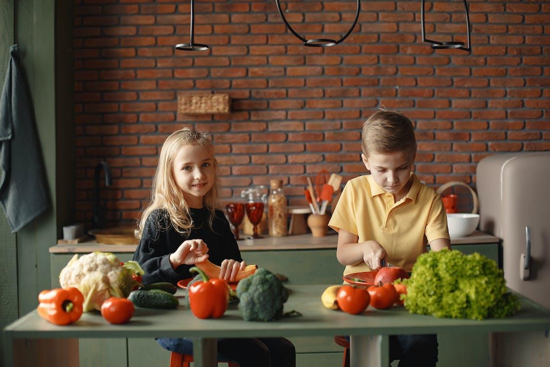 Children in the Kitchen Slicing Vegetables