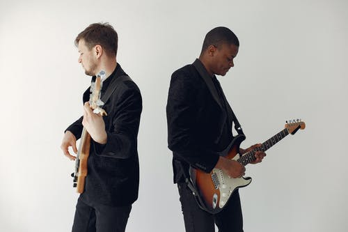 Men in Black Suit Playing Electric Guitar