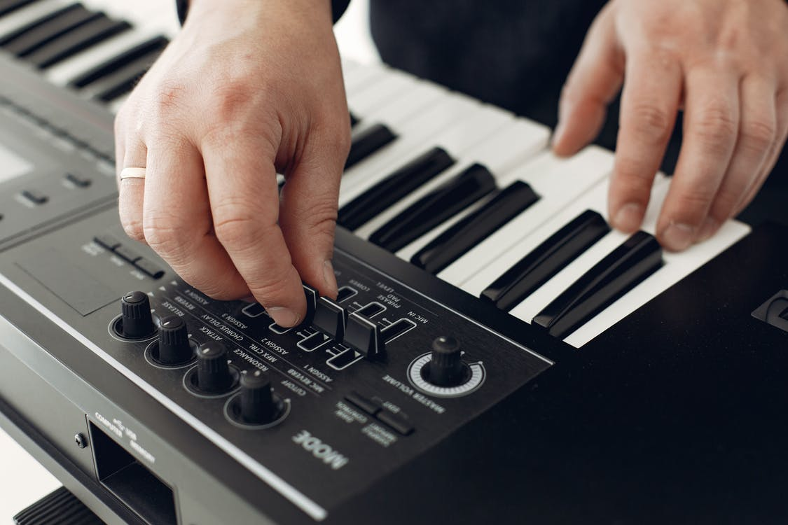 Person Playing Black and White Piano