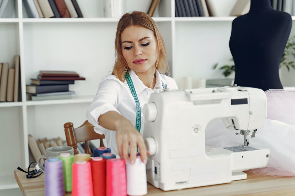 Dressmaker in front of her Sewing Machine